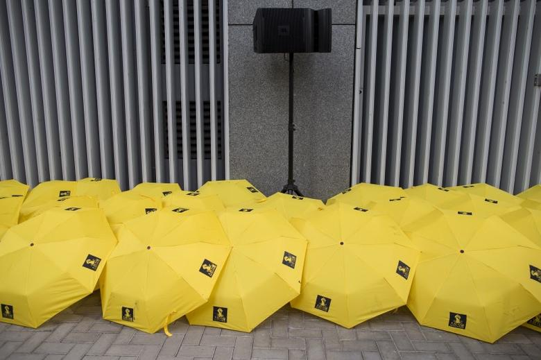 Yellow umbrellas, symbol of the Occupy Central or the so-called ''umbrella'' movement, displayed outside government headquarters in Hong Kong, China September 28, 2015.  REUTERS/Tyrone Siu