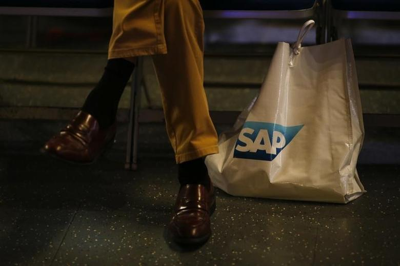 A participant sits next to a bag with SAP logo before the company's annual general meeting in Mannheim, Germany, May 20, 2015.  REUTERS/Kai Pfaffenbach