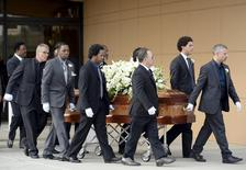 Pallbearers push the coffin of singer Natalie Cole after a funeral service in Los Angeles, California, January 11, 2016.  REUTERS/Kevork Djansezian
