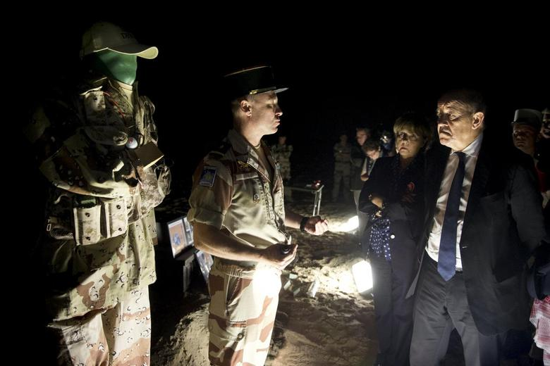 French Defence Minister Jean-Yves Le Drian (R) speaks with soldiers of the 13th Demi-Brigade of the Foreign Legion, during a visit to the military base of the Foreign Legion, in the United Arab Emirates, January 2, 2016.  REUTERS/Kenzo Tribouillard