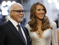 Singer Celine Dion and her husband Rene Angelil arrive at the 83rd Academy Awards at the 83rd Academy Awards in Hollywood, California, in this February 27, 2011 file photo.   REUTERS/Mario Anzuoni/Files