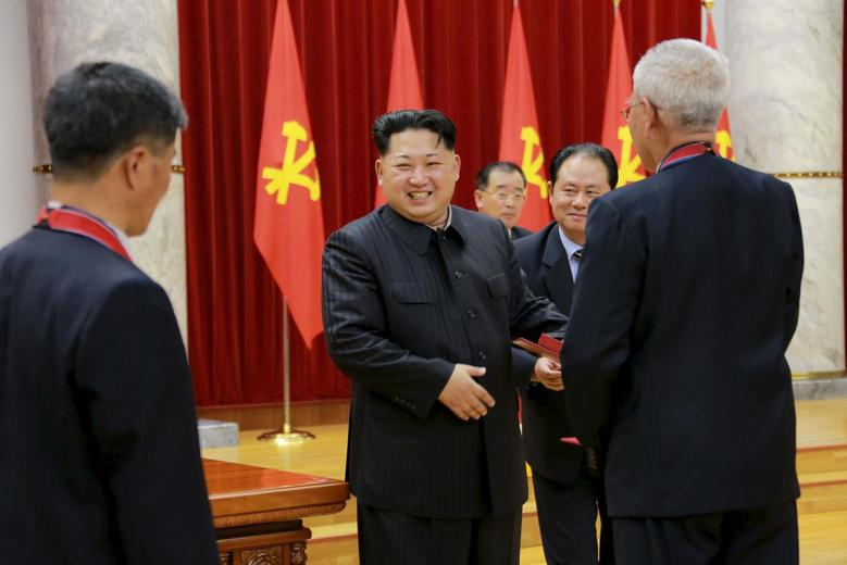 North Korean leader Kim Jong Un attends a ceremony to award party and state commendations to nuclear scientists, technicians, soldier-builders, workers and officials for their contribution to what North Korea said was a successful hydrogen bomb test, at the meeting hall of the Central Committee of the Workers' Party of Korea (WPK) in this undated photo released on January 13, 2016.     REUTERS/KCNA