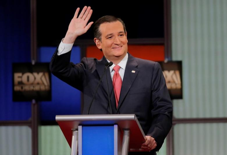 Ted Cruz waves to the crowd at the Fox Business Network Republican presidential candidates debate in North Charleston, South Carolina, January 14, 2016. REUTERS/Chris Keane . SAP is the sponsor of this coverage which is independently produced by the staff of Reuters News Agency.