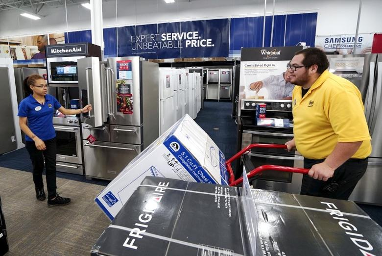 An employee pushes merchandise through a Best Buy store in Denver May 14, 2015. REUTERS/Rick Wilking