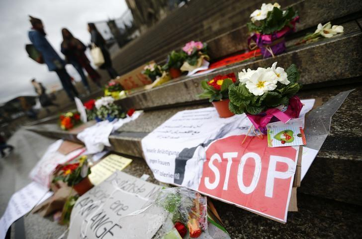 Flowers and posters are placed in the square between the city cathedral and the railway station in Cologne, Germany, January 11,  2016, where the vast majority of dozens of New Year Eve assaults on women took place.  REUTERS/Wolfgang Rattay