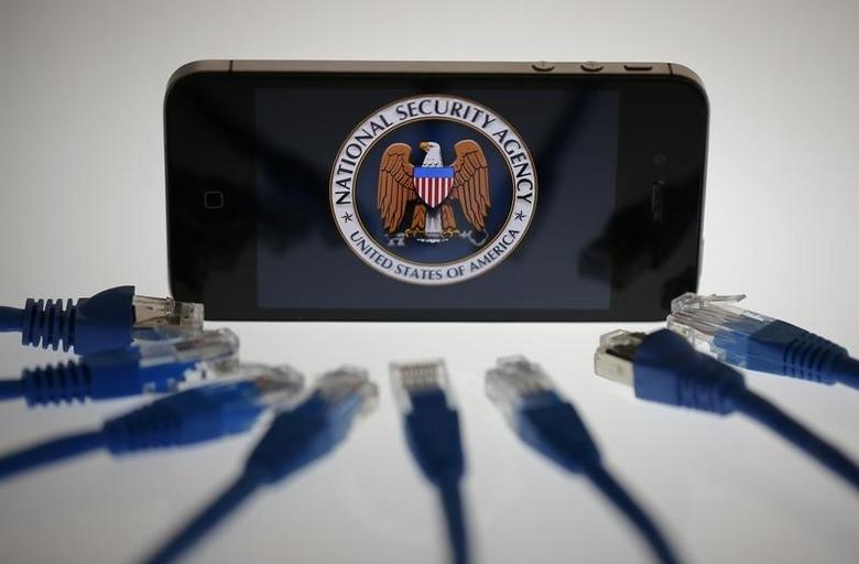 An illustration picture shows the logo of the U.S. National Security Agency on the display of an iPhone in Berlin, June 7, 2013. REUTERS/Pawel Kopczynski