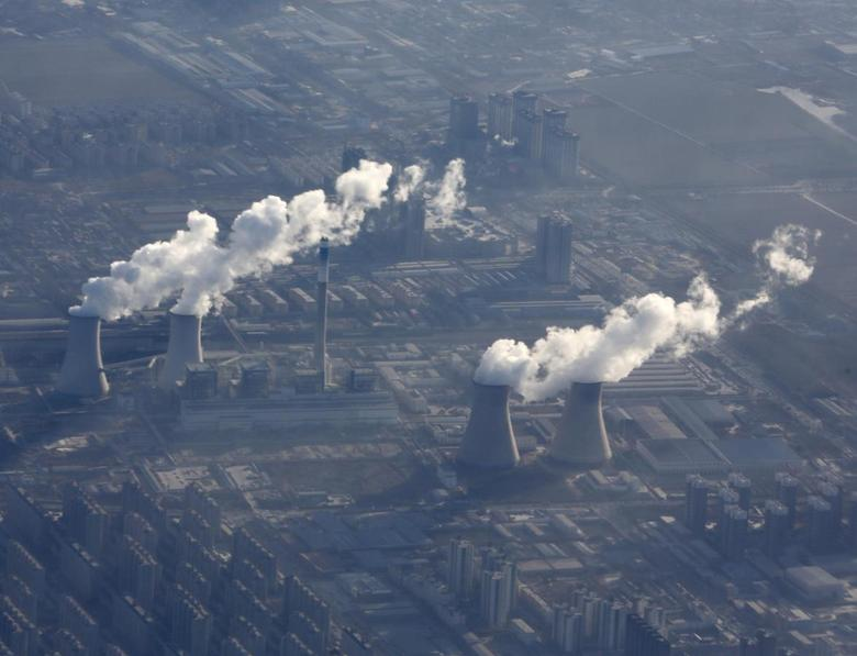 Chimneys of a power plant are pictured from a plane, on the outskirts of Beijing January 8, 2016. REUTERS/Kim Kyung-Hoon