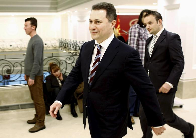 Macedonian Prime Minister Nikola Gruevski leave after the news conference in Skopje January 14, 2016. REUTERS/Ognen Teofilovski