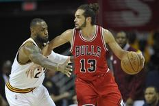 May 4, 2015; Cleveland, OH, USA; Cleveland Cavaliers forward LeBron James (23) defends Chicago Bulls center Joakim Noah (13) in the third quarter in game one of the second round of the NBA Playoffs at Quicken Loans Arena. Mandatory Credit: David Richard-USA TODAY Sports