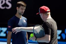 Serbia's Novak Djokovic listens to his coach Boris Becker during a practice session at Melbourne Park, Australia, January 16, 2016. The Australian Open tennis tournament starts January 18. REUTERS/Thomas Peter