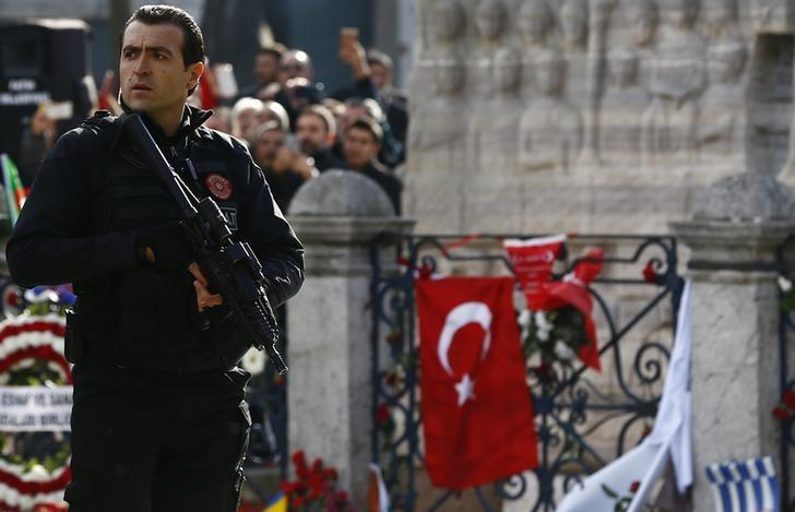A member of the presidential security stands guard at the site of Tuesday's suicide bomb attack at Sultanahmet square before the arrival of Turkish President Tayyip Erdogan in Istanbul, Turkey January 15, 2016. REUTERS/Murad Sezer