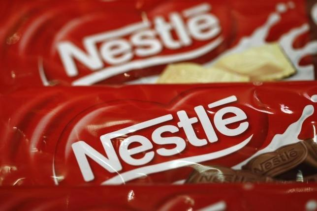 A Nestle logo is pictured on sample products on display at the company headquarters in Vevey February 19, 2015. REUTERS/Denis Balibouse
