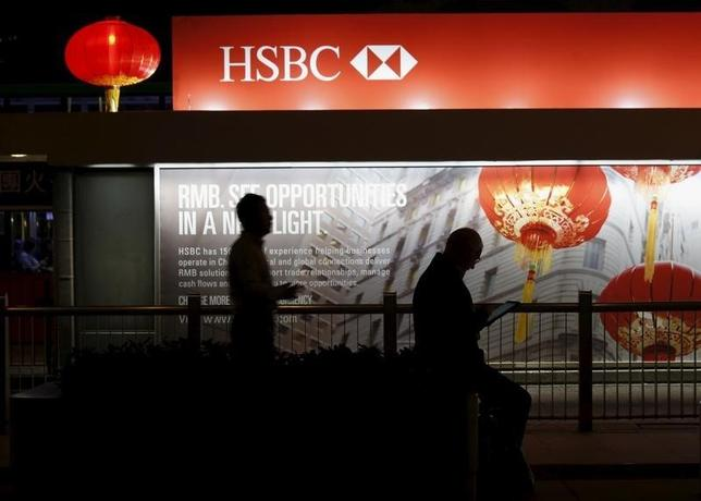 An advertisement of HSBC is displayed at a tram station outside the HSBC headquarters at the financial Central district in Hong Kong November 3, 2015.  REUTERS/Bobby Yip