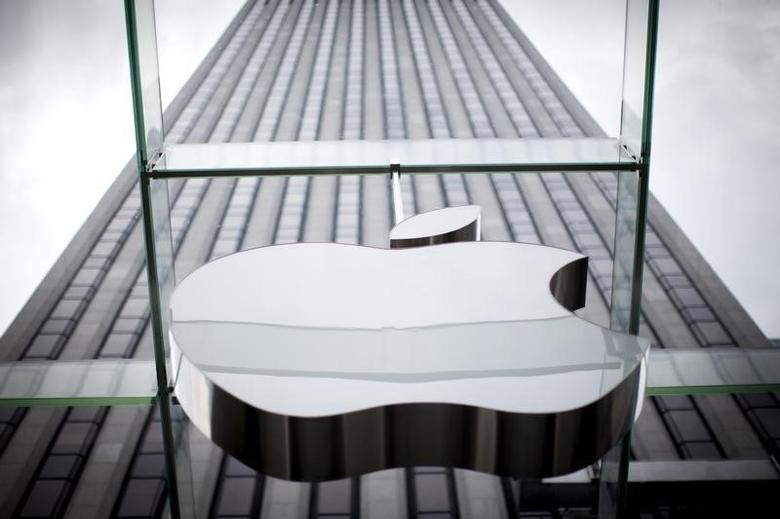 An Apple logo hangs above the entrance to the Apple store on 5th Avenue in the Manhattan borough of New York City, July 21, 2015. REUTERS/Mike Segar