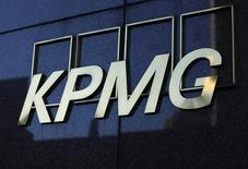 A KPMG logo is seen on their down town office tower in Los Angeles, California May 13, 2014.  REUTERS/Mike Blake