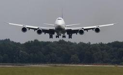 A Lufthansa Boeing 747-8 touches down at Dulles International Airport outside Washington for the first time June 1, 2012. REUTERS/Larry Downing