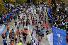 Runners run across the finish line at the 2015 New York City Marathon in New York's Central Park, November 1, 2015.  REUTERS/Mike Segar