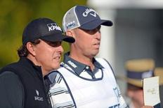 Phil Mickelson and caddie Jim Mackay look on during the first round of the CareerBuilder Challenge at La Quinta Country Club.  Credit: Joe Camporeale-USA TODAY Sports