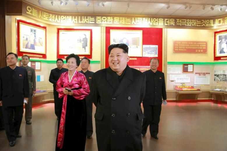 North Korean leader Kim Jong Un (2nd R) smiles during a visit to the newly built Youth Movement Museum in this undated photo released by North Korea's Korean Central News Agency (KCNA) in Pyongyang January 20, 2015.  REUTERS/KCNA