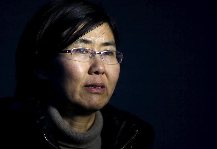 Human rights lawyer Wang Yu talks during an interview with Reuters in Beijing in this March 1, 2014 photo. REUTERS/Kim Kyung-Hoon/Files