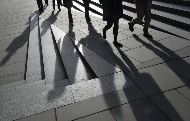 Workers are seen walking during the lunch hour in the City of London, in Britain, January 21, 2016. REUTERS/Toby Melville