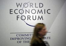 World Bank group senior official Anabel Gonzalez passes by a logo of the World Economic Forum (WEF) in the congress centre during the annual meeting of the World Economic Forum (WEF) in Davos, Switzerland January 20, 2016.  REUTERS/Ruben Sprich