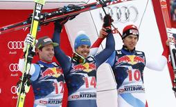 First placed Peter Fill (C) of Italy celebrates next to second placed Beat Feuz (L) of Switzerland and third placed Carlo Janka of Switzerland after competing in the men's Alpine Skiing World Cup downhill race in Kitzbuehel, Austria, January 23, 2016.      REUTERS/Leonhard Foeger