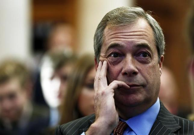 The leader of the United Kingdom Independence Party (UKIP), Nigel Farage, listens during a Leave.EU campaign news conference in central London, Britain November 18, 2015. REUTERS/Stefan Wermuth