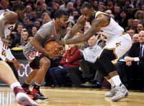 Jan 23, 2016; Cleveland, OH, USA; Cleveland Cavaliers forward LeBron James (23) and Chicago Bulls guard Aaron Brooks (0) battle for the ball during the fourth quarter at Quicken Loans Arena. The Bulls won 96-83. Mandatory Credit: Ken Blaze-USA TODAY Sports