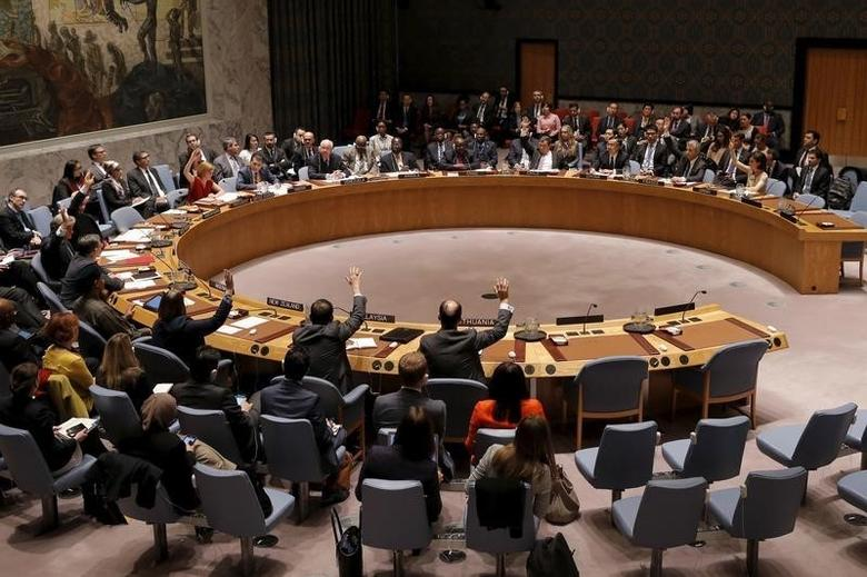 File photo of United Nations Security Council members casting their votes in favor of the adoption of the agenda during a meeting of the United Nations Security Council on alleged human rights abuses by North Korea which has been accused by a U.N. inquiry of abuses comparable to Nazi-era atrocities at U.N. headquarters in New York, December 10, 2015. REUTERS/Mike Segar