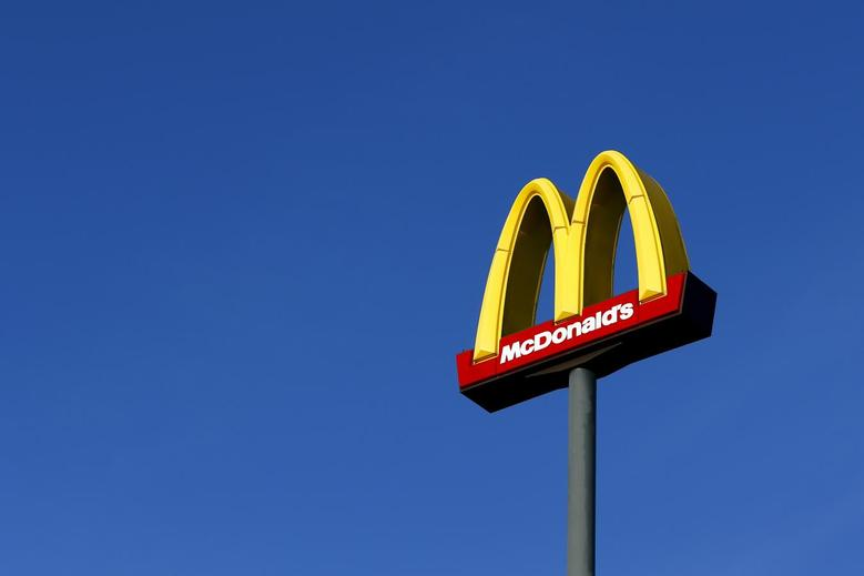 A sign for U.S. fast food restaurant chain McDonald's is seen outside one of their restaurants in Sint-Pieters-Leeuw, near Brussels in this December 3, 2015, file photo.    McDonald's is expected to report Q4 earnings January 25, 2016. REUTERS/Yves Herman/Files