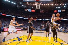 January 25, 2016; Oakland, CA, USA; Golden State Warriors guard Stephen Curry (30, top) is fouled by San Antonio Spurs guard Jonathon Simmons (17) during the third quarter at Oracle Arena. The Warriors defeated the Spurs 120-90. Mandatory Credit: Kyle Terada-USA TODAY Sports