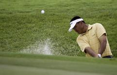Mardan Mamat of Singapore hits the ball out of the bunker at the 15th hole during the CIMB Asia Pacific Classic Malaysia golf tournament in Kuala Lumpur October 31, 2010.   REUTERS/Bazuki Muhammad