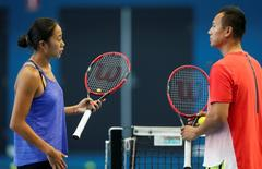 China's Zhang Shuai talks with her coach Liu Shuo during a practice session at the Australian Open tennis tournament at Melbourne Park, Australia, January 26, 2016. REUTERS/Brandon Malone