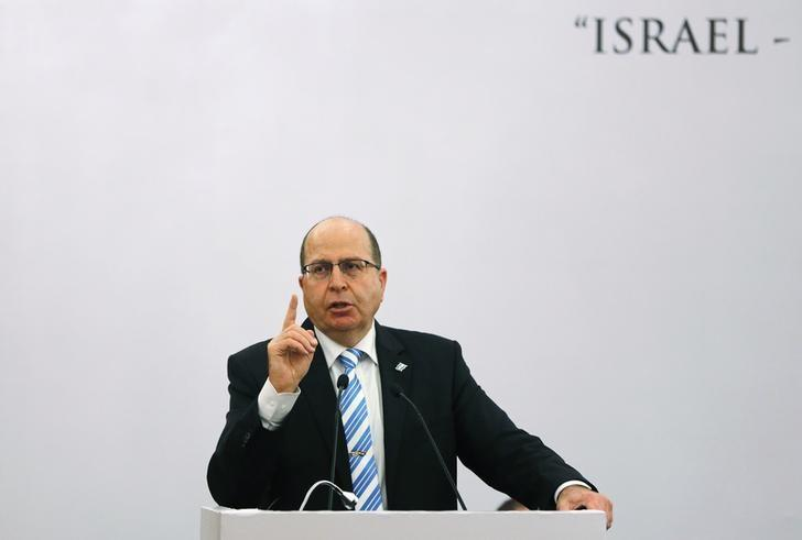 Israeli Defence Minister Moshe Ya'alon gestures while addressing a gathering during a lecture themed ''Israel-India Partnership in the 21st Century''?, in New Delhi February 19, 2015. REUTERS/Adnan Abidi
