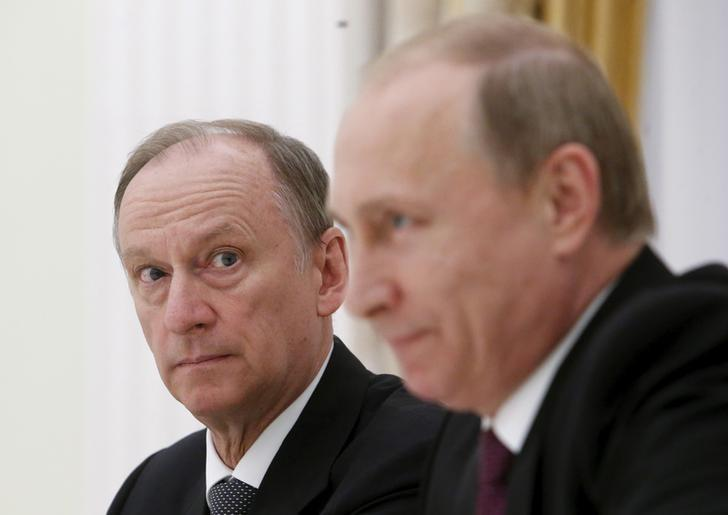 Russian Security Council Secretary Nikolai Patrushev (L) looks at President Vladimir Putin during a meeting with the BRICS countries' senior officials in charge of security matters at the Kremlin in Moscow, Russia, May 26, 2015. REUTERS/Sergei Karpukhin