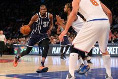 Jan 26, 2016; New York, NY, USA; Oklahoma City Thunder small forward Kevin Durant (35) drives against New York Knicks power forward Derrick Williams (23) and center Robin Lopez (8) during the first quarter at Madison Square Garden. Mandatory Credit: Brad Penner-USA TODAY Sports