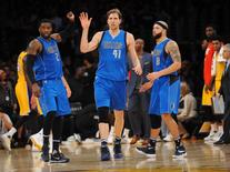 January 26, 2016; Los Angeles, CA, USA; Dallas Mavericks forward Dirk Nowitzki (41) is congratulated by guard Wesley Matthews (23) and guard Deron Williams (8) after scoring a basket against Los Angeles Lakers during the second half at Staples Center. Mandatory Credit: Gary A. Vasquez-USA TODAY Sports