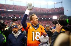 Jan 24, 2016; Denver, CO, USA; Denver Broncos quarterback Peyton Manning (18) waves to the crowd after the AFC Championship football game against the New England Patriots at Sports Authority Field at Mile High. Mark J. Rebilas-USA TODAY Sports