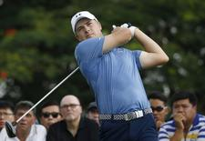 Jordan Spieth of the U.S. tees off on the ninth hole during the first round of the SMBC Singapore Open golf tournament at Sentosa's Serapong golf course in Singapore January 28, 2016. REUTERS/Edgar Su