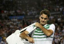 Switzerland's Roger Federer reacts as he leaves after losing his semi-final match against Serbia's Novak Djokovic at the Australian Open tennis tournament at Melbourne Park, Australia, January 28, 2016. REUTERS/Tyrone Siu