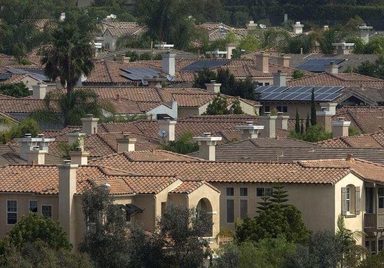 Solar panels are pictured on the rooftops of residential homes in San Diego, California in this August 21, 2015 file photo.  REUTERS/Mike Blake/Files
