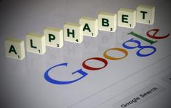 "Letters spell the word ""Alphabet"" as they are seen on a computer screen with a Google search page in this photo illustration taken in Paris, France, August 11, 2015.     REUTERS/Pascal Rossignol"