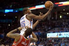 Jan 29, 2016; Oklahoma City, OK, USA; Oklahoma City Thunder forward Kevin Durant (35) drives to the basket against Houston Rockets forward Trevor Ariza (1) during the fourth quarter at Chesapeake Energy Arena. Mandatory Credit: Mark D. Smith-USA TODAY Sports