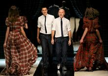 Italian designers Domenico Dolce (R) and Stefano Gabbana acknowledge applause on the catwalk at the end of the D&G Fall/Winter 2008/09 women's collection during Milan Fashion Week February 18, 2008. REUTERS/Alessandro Garofalo