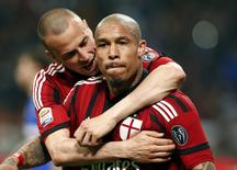 AC Milan's Nigel de Jong (R) celebrates after scoring with his team-mate Luca Antonelli during their Italian Serie A soccer match against Sampdoria at San Siro stadium in Milan April 12, 2015.  REUTERS/Stefano Rellandini