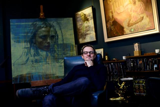 British artist Jonathan Yeo speaks during an interview with Reuters at his studios in west London, Britain February 1, 2016.  REUTERS/Dylan Martinez