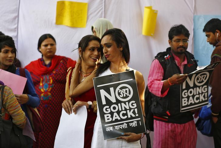 Gay rights activists hold placards during a protest in New Delhi February 11, 2014. REUTERS/Anindito Mukherjee/Files
