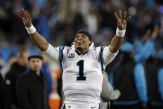 Jan 24, 2016; Charlotte, NC, USA; Carolina Panthers quarterback Cam Newton (1) celebrates on the side lines during the fourth quarter against the Arizona Cardinals in the NFC Championship football game at Bank of America Stadium.  Jeremy Brevard-USA TODAY Sports