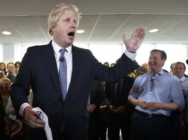 Britain's Prime Minister David Cameron (R) laughs as London Mayor Boris Johnson speaks during an election rally in Hendon in north London, in this file photograph dated May 5, 2015.   REUTERS/Toby Melville/files